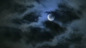 stock-footage-full-moon-in-moonlight-night-behind-clouds-time-lapse